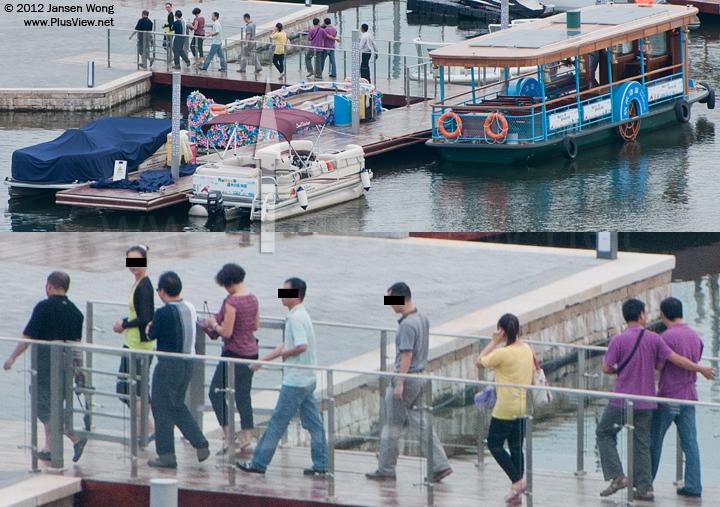 大型游船返回欢乐海岸南湖狂欢码头后,8位游客上岸离开